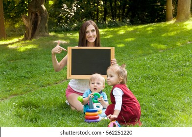 mother engaged in the early development of children on nature in the park. Parenting