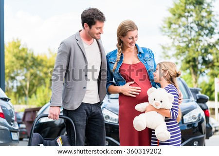 Mother, father, and child buying car at dealership, a new family auto