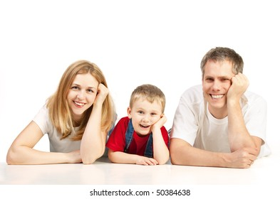 Mother, father and child lying on the floor
