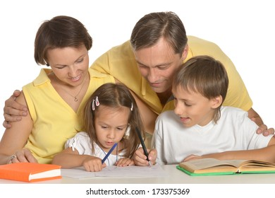 Mother and father doing homework with their kids