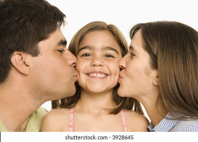 Mother and father kissing smiling daughter   on opposite cheeks.