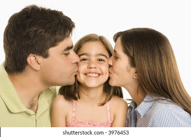 Mother and father kissing smiling daughter on cheek.