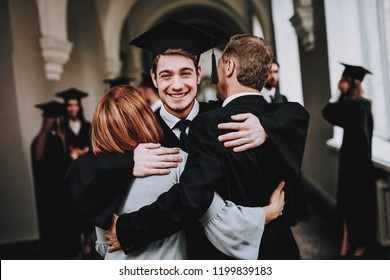 Mother. Father. Son. Hugs. University. Graduates. Parents. Congratulations. Student. Finish Studies. Happy. Good Mood. Have Fun. Architecture. Happiness. Relations. Diploma. Standing. Corridor.