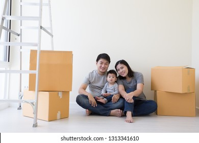 Mother father and son in a new home. Housing a young Asian family concept