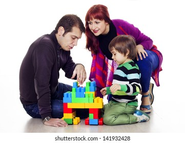 Mother, father and son playing lego
