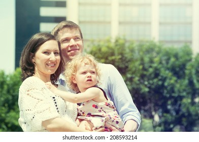 Mother and father with their cute little daughter