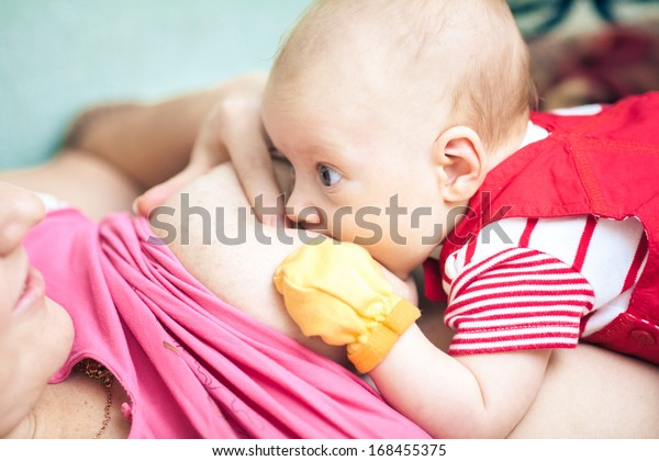 Mother feeding her baby
