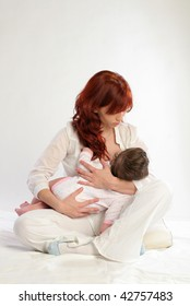 Mother feeding her baby. Cradle