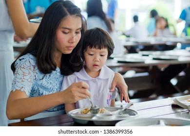mother feeding her child, kid eating