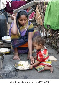 mother feeding her child on the street