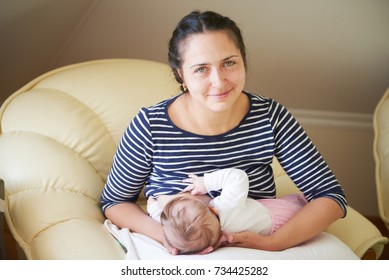 Mother feeds her baby with her breast. Breastfeeding, lactation