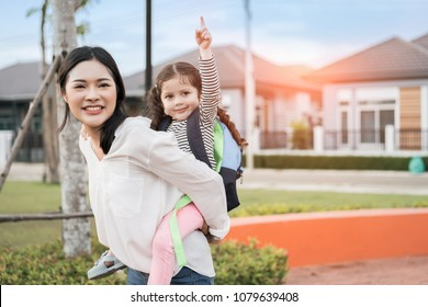 Mother get a daughter pupil from school after study school back to home with schoolbag family lifestyle.