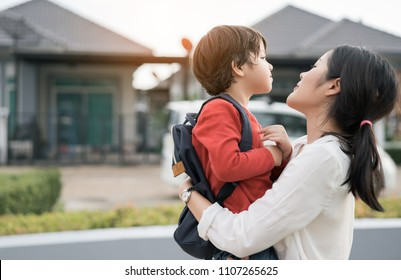 Mother get a son pupil from school after study school back to home village with schoolbag family lifestyle.