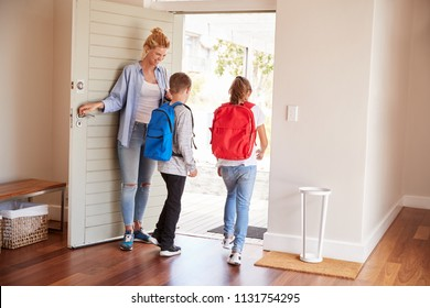 Mother Getting Children Ready To Leave House For School