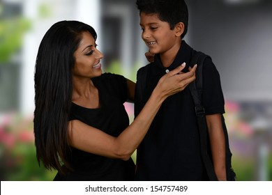 Mother getting her son ready to go to school