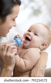 Mother gives to drink water baby son from bottle