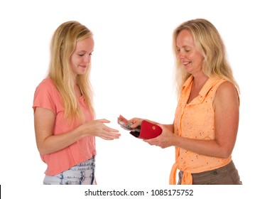 A mother giving Australian money to daughter.