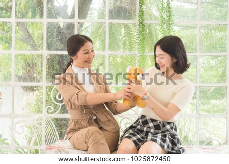 Mother Giving Birthday Present To Teen Daughter Concept Family