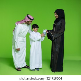 Mother giving gift to her son
