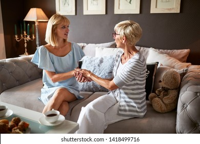 Mother giving parental advice to her daughter in room