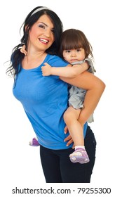 Mother giving piggyback ride to her little daughter isolated on white background