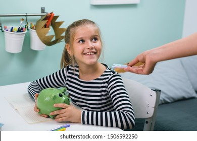 mother giving pocket money to her preteen daughter