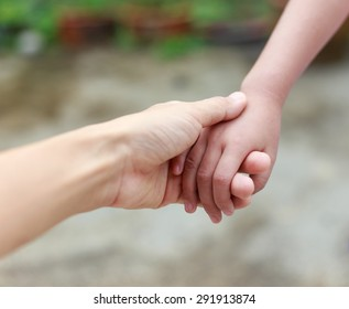 Mother hand hold child hand with love