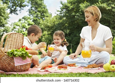 Mother having picnic with her children