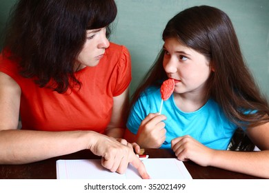 mother help teenager daughter do difficult homework