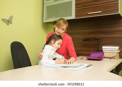 Mother helping her daughter