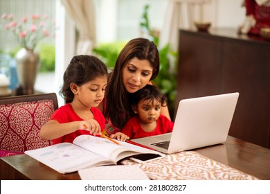 Mother helping her daughter with homework