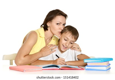 Mother helping her son doing homework