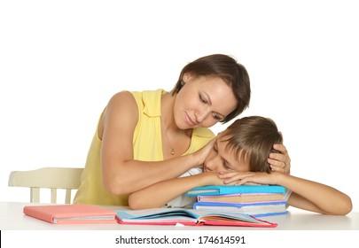 Mother helping her son doing homewor
