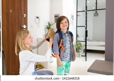 Mother helping son get ready for school