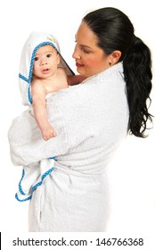 Mother and her baby boy in bathrobes after bath isolated on white background