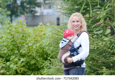 Mother and her baby with baby sling.