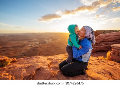 A mother and her baby son visit Canyonlands National park in Utah, USA