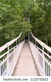 The mother and her child cross the hanging bridge in the valley of Tempi in Larissa to go to the church of Agia Paraskevi