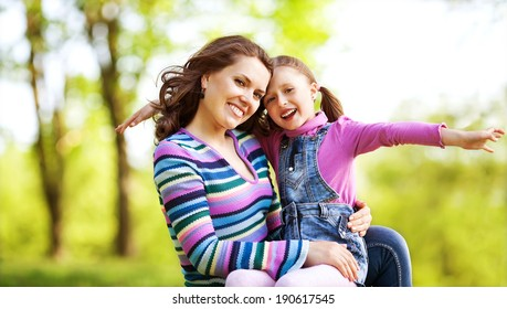 Mother and her child enjoy the early spring. Mother day.