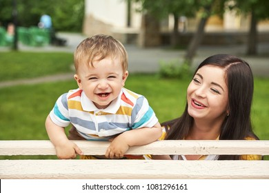 mother with her child outdoor. Mom and son walking in a summer park