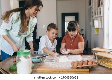 mother with her children baking at home