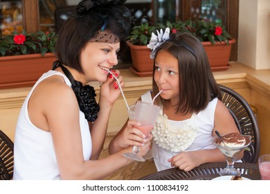 mother with her daughter in a cafe