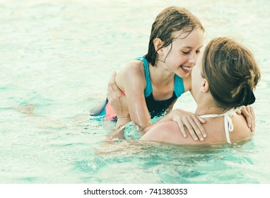 Mother and her daughter having fun in SPA.