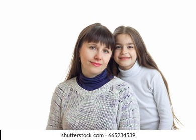 mother with her daughter hugs and smiles on camera
