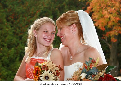 Mother and her daughter on her wedding day.