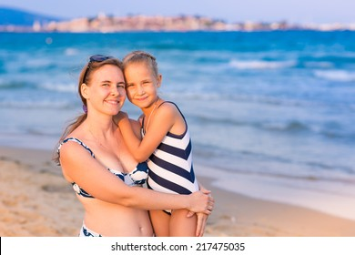 Mother with her daughter at the seashore, happy family concept
