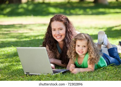 Mother and her daughter working on the laptop