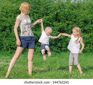 Mother and her daughters having fun