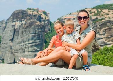 Mother and her kids looking at the town of Kalambaka bird's eye view. Meteora, Greece.