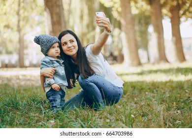 mother and her little daughter in the autumn park